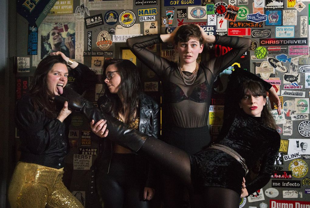 Seattle band Thunderpussy, from left: Whitney Petty, Leah Julius, Ruby Dunphy and Molly Sides, in 2017 after playing a show at Elysian Brewing on Capitol Hill. (Lindsey Wasson / The Seattle Times)