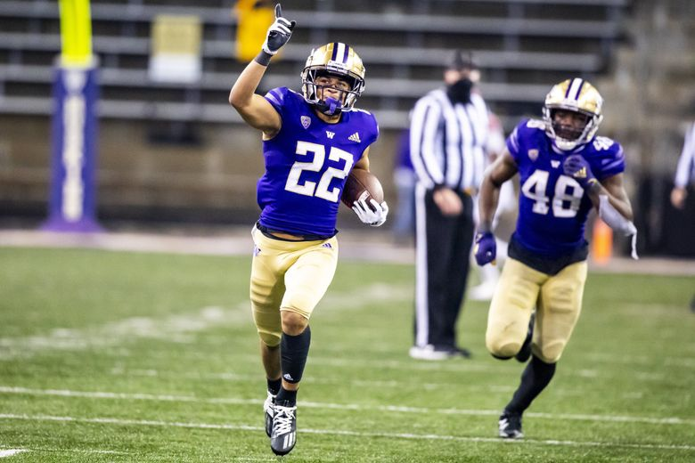 Washington defensive back Trent McDuffie celebrates after picking off a pass from Utah quarterback Jake Bentley on their final drive as the University of Washington Huskies defeated the Utah Utes 24-21 at Husky Stadium in Seattle Saturday November 28, 2020. (Bettina Hansen / The Seattle Times)