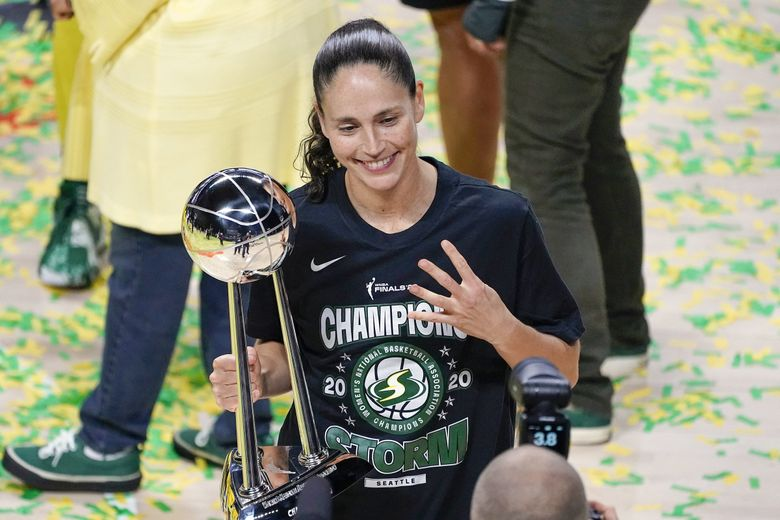 Seattle Storm guard Sue Bird poses for a photo after the team won the WNBA championship last year. (Chris O'Meara / AP)