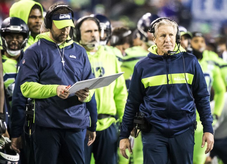 Seahawks head coach Pete Carroll and offensive coordinator Brian Schottenheimer figure out what to do in the red zone as the Seattle Seahawks take on the Minnesota Vikings for Monday Night Football at CenturyLink Field in Seattle Monday December 10, 2018.  (Bettina Hansen / The Seattle Times)