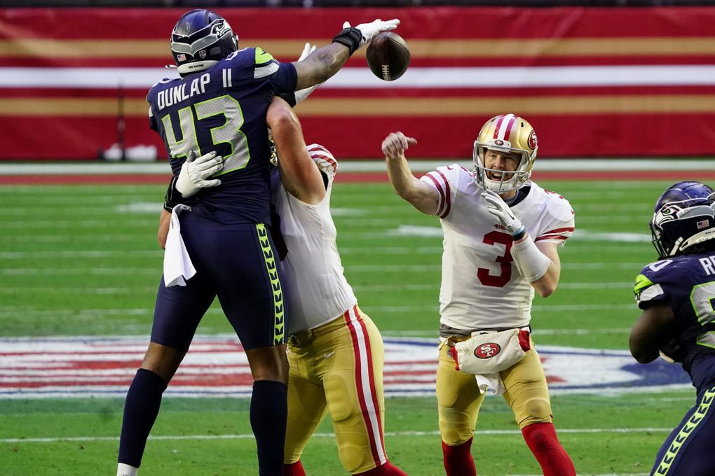 San Francisco 49ers quarterback C.J. Beathard (3) has his pass blocked by Seattle Seahawks defensive end Carlos Dunlap (43) during the first half of an NFL football game, Sunday, Jan. 3, 2021, in Glendale, Ariz. (AP Photo/Rick Scuteri) AZMY125 AZMY125 (Rick Scuteri / The Associated Press)