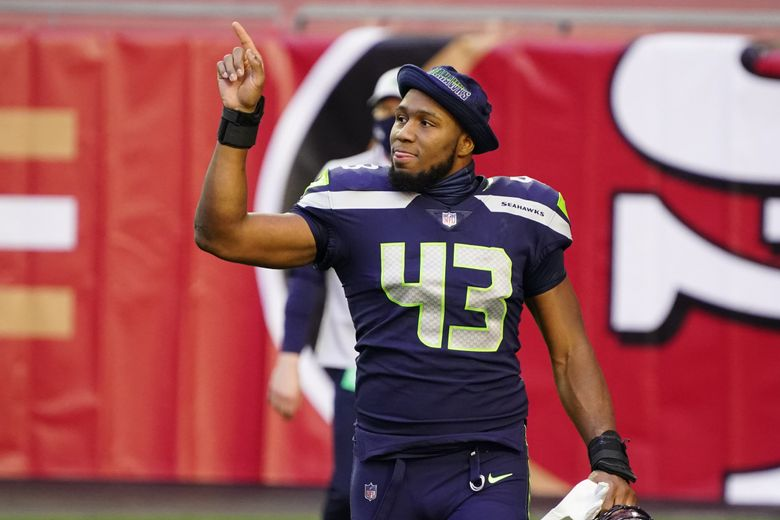 Seattle Seahawks defensive end Carlos Dunlap (43) during an NFL football game against the San Francisco 49ers, Sunday, Jan. 3, 2021, in Glendale, Ariz. (AP Photo/Rick Scuteri)   (Rick Scuteri / The Associated Press)