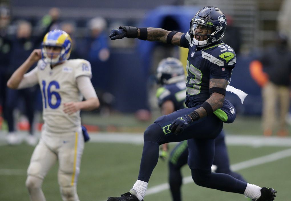 Seattle Seahawks strong safety Jamal Adams (33) reacts to a play with Los Angeles Rams quarterback Jared Goff (16) in the background, during the second half of an NFL football game, Sunday, Dec. 27, 2020, in Seattle. (AP Photo/Scott Eklund) SE154 SE154 (Scott Eklund / The Associated Press)