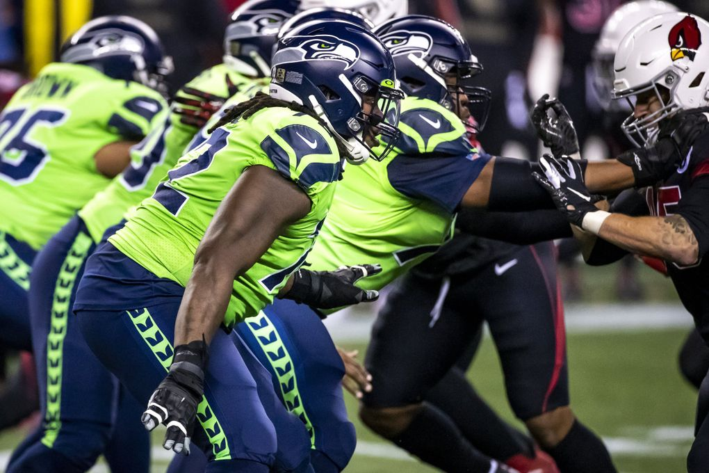 SEAHAWKS FILE —  Seahawks offensive tackle Brandon Shell and the offensive line hold the pocket as the Seattle Seahawks take on the Arizona Cardinals for Thursday Night Football at Lumen Field in Seattle Thursday November 19, 2020. 215694 (Bettina Hansen / The Seattle Times)