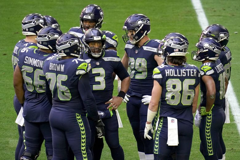 Seattle Seahawks quarterback Russell Wilson (3) huddles up his teammates during the first half of an NFL football game against the San Francisco 49ers, Sunday, Jan. 3, 2021, in Glendale, Ariz. (AP Photo/Ross D. Franklin) AZMY AZMY (Ross D. Franklin / The Associated Press)