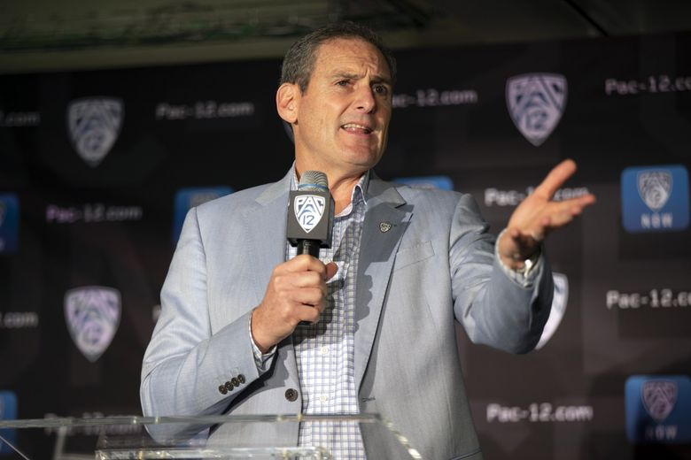 Pac-12 commissioner Larry Scott speaks during the college basketball media day in San Francisco (D. Ross Cameron / AP)