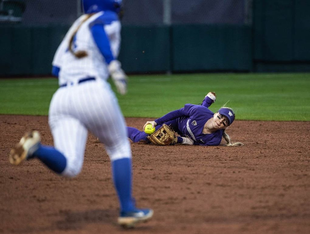 Washington shortstop Sis Bates makes a great play knocking down the hard grounder, and forcing Kentucky baserunner Jaci Babbs at second in the 2nd inning.  The Kentucky Wildcats played the Washington Huskies in game 2 of the NCAA Super Regionals in softball Saturday, May 25, 2019 at Husky Softball Stadium in Seattle, WA. (Dean Rutz / The Seattle Times)