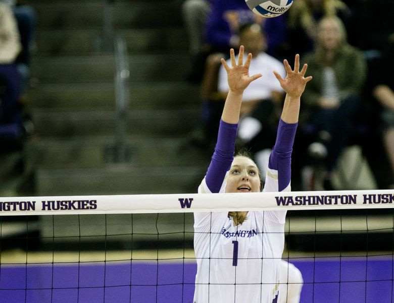 Middle Blocker Lauren Sanders jumps to block the ball as the UW Huskies take on the Washington State Cougars in 2018. (Rebekah Welch / The Seattle Times)