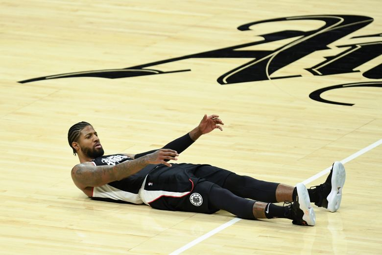 It was a flat day for the Los Angeles Clippers and guard Paul George last Sunday in a 124-73 loss to Dallas. L.A. made just 4 of 33 three-pointers. (Kyusung Gong / The Associated Press)
