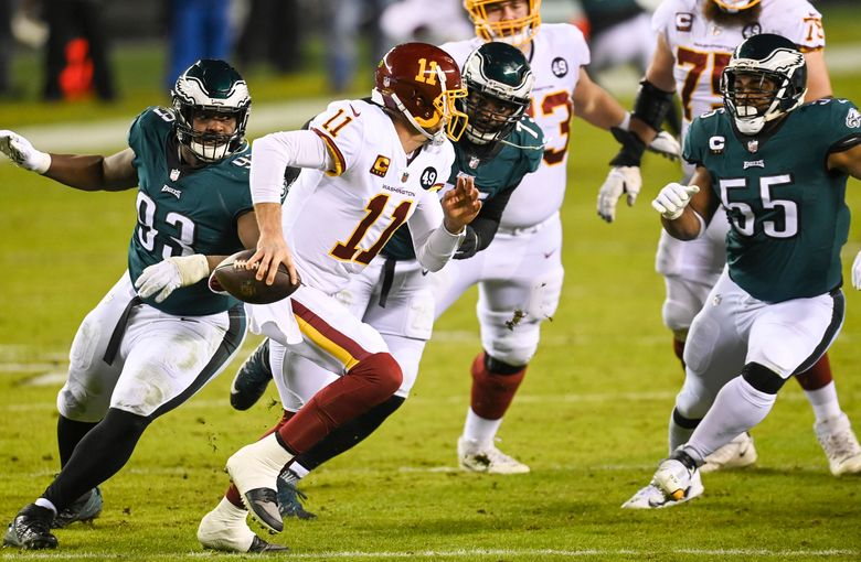 Quarterback Alex Smith helps the Washington Football Team on Sunday to secure a spot in the playoffs. The team will face the Tampa Bay Buccaneers and quarterback Tom Brady on Saturday. (Washington Post photo by Jonathan Newton).