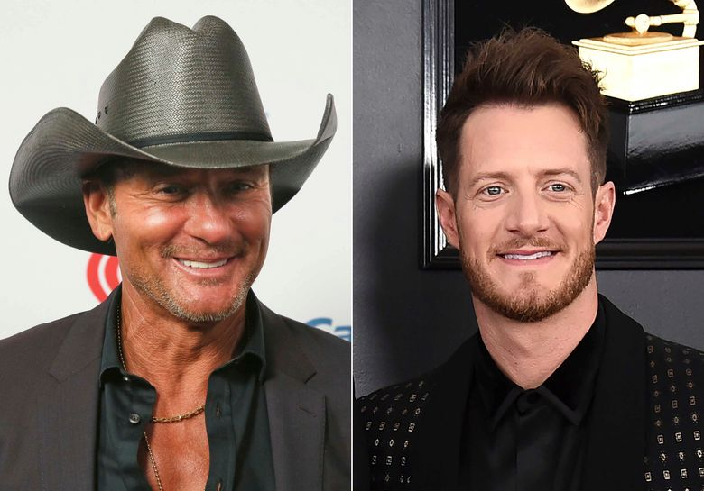 """This combination photo shows Tim McGraw at the iHeartCountry Festival in Austin, Texas on May 4, 2019, left, and Tyler Hubbard of the duo Florida Georgia Line at the 61st annual Grammy Awards in Los Angeles on Feb. 10, 2019. Hubbard and McGraw are asking people to walk a mile in someone else's shoes in a call for unity on their new duet """"Undivided."""" Hubbard wrote the song while isolating on his tour bus after testing positive for COVID-19 last year. He said the division in America in 2020 weighed heavily on his heart as he wrote the song. McGraw said the song isn't political, but makes a case for empathy instead of disagreement. (AP Photo)"""