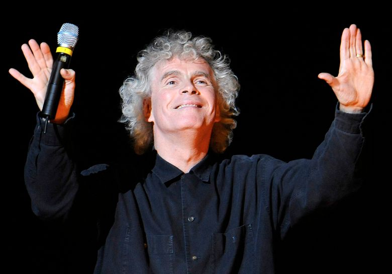 """FILE – In this March 27, 2010 file photo, conductor Sir Simon Rattle gestures prior to a dress rehearsal for Richard Wagner's opera """"Goetterdaemmerung"""" which was part of the Salzburg Easter Festival in Salzburg, Austria. Simon Rattle is set to leave his job as musical director at the London Symphony Orchestra to lead the Munich-based Bavarian Radio Symphony Orchestra. The the two organizations said Monday, Jan. 11, 2021 that the acclaimed conductor will become the German orchestra's chief conductor in 2023. (AP Photo/Kerstin Joensson, File)"""