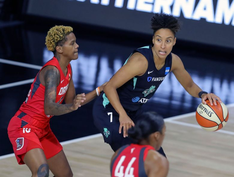 FILE – In this Sept. 3, 2020, file photo, New York Liberty's Layshia Clarendon (7) is defended by Atlanta Dream's Courtney Williams (10) during the first half of a WNBA basketball game in Bradenton, Fla. Clarendon, who identifies as transgender and nonbinary, announced on social media Friday, Jan. 29, 2021, that they had surgery to remove breast tissue. (AP Photo/Mike Carlson, File)