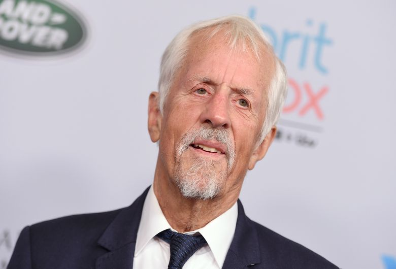 """FILE – Michael Apted arrives at the BAFTA Los Angeles Britannia Awards on Oct. 25, 2019, in Beverly Hills, Calif. Apted, the acclaimed British director of the """"Up"""" documentaries series and films as diverse as the Loretta Lynn biopic """"Coal Miner's Daughter"""" and the James Bond film """"The World is Not Enough"""" has died. A representative for the Directors Guild of America said his family informed the organization that he passed Thursday, Jan. 7, 2021. He was 79. (Photo by Jordan Strauss/Invision/AP, File)"""