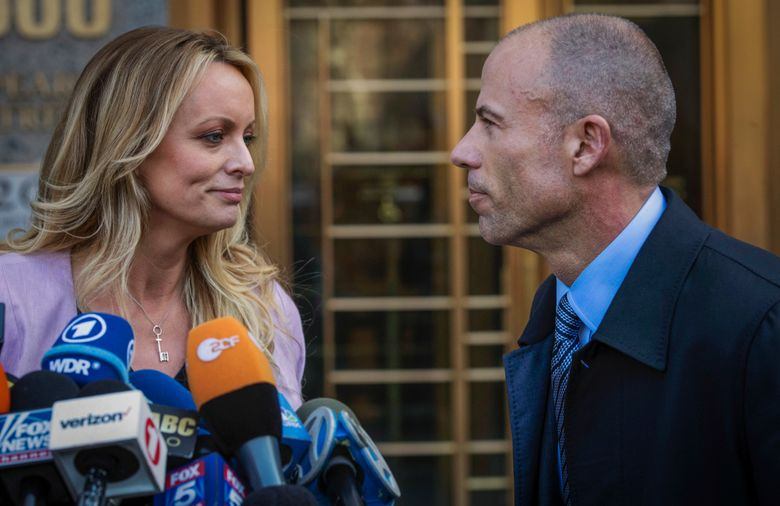 FILE – In this April 16, 2018, file photo, adult film actress Stormy Daniels, left, stands with her then lawyer, Michael Avenatti, during a press conference outside federal court in New York. A trial for Avenatti to face charges that he cheated ex-client Daniels out of proceeds from her book was delayed Friday, Jan. 8, 2021, until next year. (AP Photo/Mary Altaffer, File)