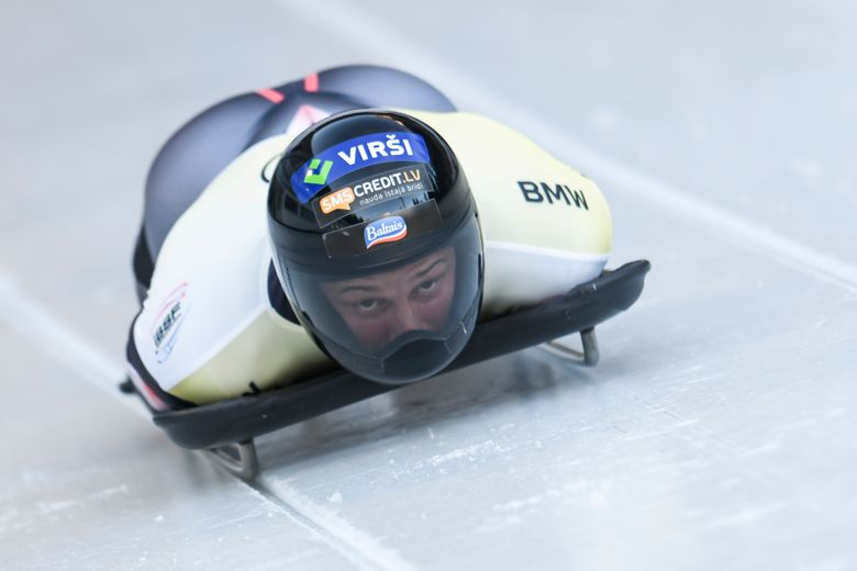 Latvian skeleton pilot Martins Dukurs competes in the men's skeleton world cup on the artificial ice track at Koenigssee, Germany, Friday, Jan.22, 2021. (Tobias Hase/dpa via AP)