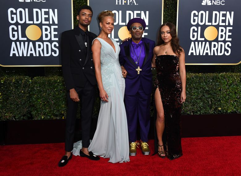 FILE – Director Spike Lee, second right, and his family, from left, son Jackson Lee, wife Tonya Lewis Lee and daughter Satchel Lee, right, arrive at the 76th annual Golden Globe Awards in Beverly Hills, Calif. on  Jan. 6, 2019. Lee's daughter and son have been chosen as the Golden Globe ambassadors to assist with the awards ceremony. The Hollywood Foreign Press Association announced Tuesday, Jan. 12, 2021, that Satchel and Jackson Lee will assume the ambassador roles for the 78th annual Golden Globes Awards in February. (Photo by Jordan Strauss/Invision/AP, File)