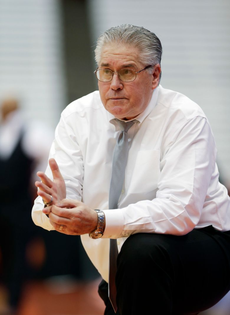FILE – In this March 18, 2016, file photo, Army coach Dave Magarity watches from the bench during a first-round game against Syracuse in the NCAA women's college basketball tournament in Syracuse, N.Y. Magarity will retire at the end of the season, according to a person familiar with the decision. The person spoke to The Associated Press on condition of anonymity on Thursday, Jan. 28, 2021, because no official announcement has been made. (AP Photo/Mike Groll, File)