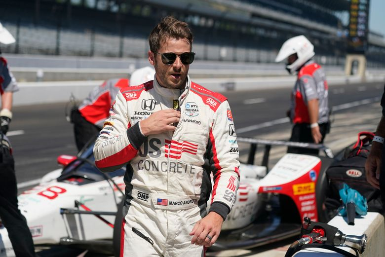 FILE – Marco Andretti walks in the pits during the final practice session for the Indianapolis 500 auto race at Indianapolis Motor Speedway, in this Friday, Aug. 21, 2020, file photo. Marco Andretti will not run a full IndyCar schedule in 2021 as last year's Indianapolis 500 pole-winner said he's reprioritizing his racing. He's still expected to compete in the Indy 500.(AP Photo/Darron Cummings, File)
