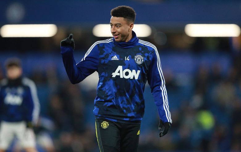 FILE – In this Wednesday, Oct. 30, 2019 file photo, Manchester United's Jesse Lingard gestures during warmup before their English League Cup soccer match against Chelsea at Stamford Bridge in London. Manchester United manager Ole Gunnar Solskjaer on Friday, Jan. 29, 2021 says Jesse Lingard and Marcos Rojo are set to leave the club before the end of the January transfer window. Lingard is moving to fellow Premier League team West Ham on loan until the end of the season. (AP Photo/Ian Walton, file)