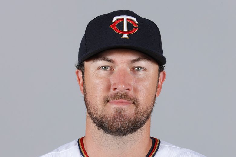 """FILE – This is a 2018 file photo showing Minnesota Twins baseball player Phil Hughes. Phil Hughes has retired from baseball, more than two years after throwing his last pitch. The 34-year-old right-hander said on Twitter on Sunday, Jan. 3, 2021, he was announcing what's been """"fairly apparent""""  to most of these last couple years."""" (AP Photo/John Minchillo, File)"""