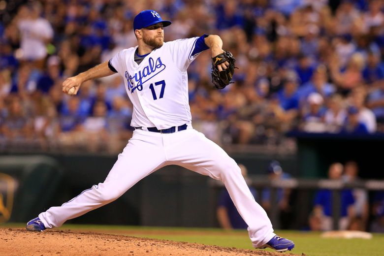 FILE – In this June 13, 2016, file photo, Kansas City Royals relief pitcher Wade Davis throws during a baseball game against the Cleveland Indians at Kauffman Stadium in Kansas City, Mo. Reliever Wade Davis is returning to the Kansas City Royals, the team he helped pitch to the 2015 World Series title. Davis and the Royals agreed Wednesday, Jan. 20, 2021, to a minor league contract, and the 35-year-old right-hander will go to spring training trying to earn a spot on the major league roster. (AP Photo/Orlin Wagner, File)