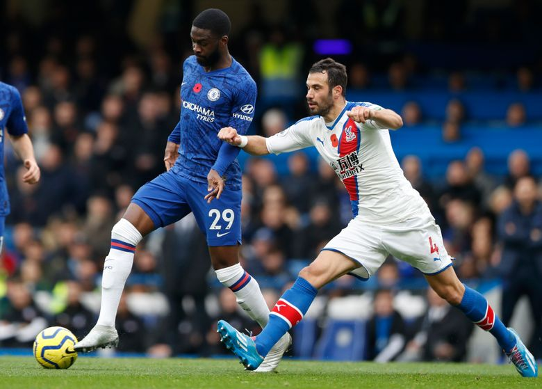 FILE – In this Saturday, Nov. 9, 2019 filer, Crystal Palace's Luka Milivojevic, right, challenges Chelsea's Fikayo Tomori during their English Premier League soccer match between Chelsea and Crystal Palace at Stamford Bridge stadium in London. Fikayo Tomori was loaned from Chelsea to AC Milan on Friday through the end of the season — giving the Rossoneri an added option in defense in their bid to win Serie A. (AP Photo/Alastair Grant, File)