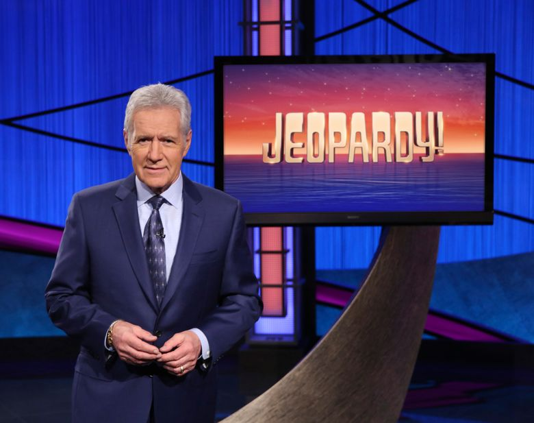 """FILE – This image released by Jeopardy! shows Alex Trebek, host of the game show """"Jeopardy!"""" Trebek's final week of episodes will air Monday, Jan. 4 through Friday, Jan. 8, 2021. All five episodes were taped in late October. (Jeopardy! via AP)"""