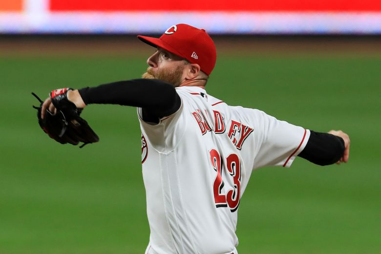 FILE – In this Sept. 14, 2020, file photo, Cincinnati Reds' Archie Bradley throws during the team's baseball game against the Pittsburgh Pirates in Cincinnati. The Philadelphia Phillies and Bradley have agreed on a $6 million, one-year contract, according to a person familiar with the deal. The person spoke to The Associated Press on condition of anonymity Thursday night, Jan. 14, 20201, because the agreement is pending a successful physical. (AP Photo/Aaron Doster, File)