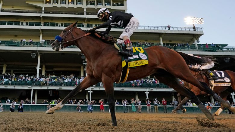 FILE – In this Sept. 5, 2020, file photo, Authentic crosses the finish line with jockey John Velazquez to win the Kentucky Derby horse race at Churchill Downs in Louisville, Ky. Authentic was honored as Horse of the Year at the 50th annual Eclipse Awards on Thursday night, Jan. 28. The ceremony was held virtually because of the coronavirus pandemic.(AP Photo/Jeff Roberson, File)