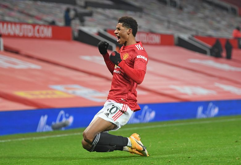 Manchester United's Marcus Rashford celebrates after scoring the opening goal during the English Premier League soccer match between Manchester Utd and Wolverhampton Wanderers at Old Trafford stadium in Manchester, England, Tuesday,Dec. 29, 2020. (Michael Regan, Pool via AP)