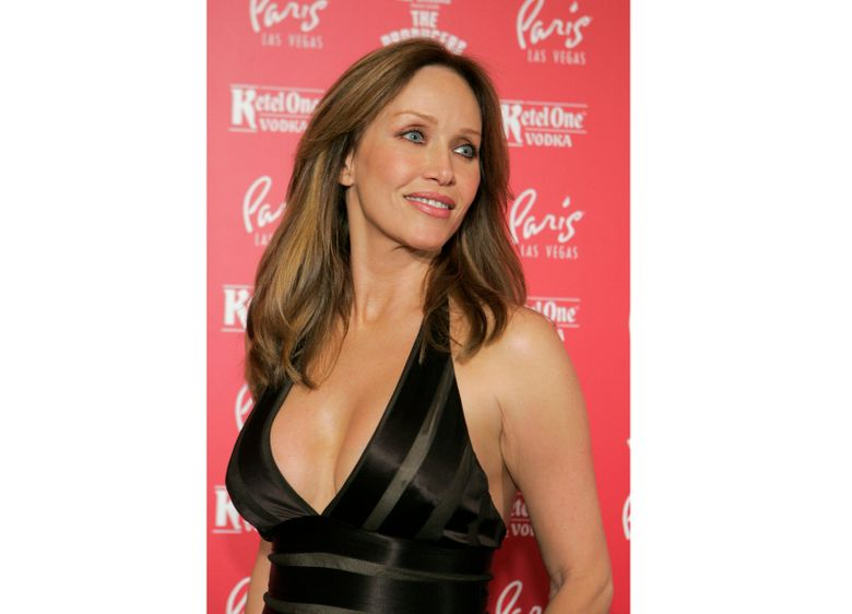 """FILE – Actress Tanya Roberts poses for photos at the grand opening of the musical comedy """"The Producers"""" at the Paris hotel-casino in Las Vegas on Feb. 9, 2007. Roberts, who captivated James Bond in """"A View to a Kill"""" and later played Midge Pinciotti in the sitcom """"That '70s Show,"""" has been hospitalized after falling at her home. The actor had mistakenly been reported dead by her publicist Mike Pingel earlier Monday, Jan. 4 2021. Pingel told The Associated Press Monday afternoon that Roberts, 65, is alive but in poor condition. (AP Photo/Jae C. Hong, File)"""