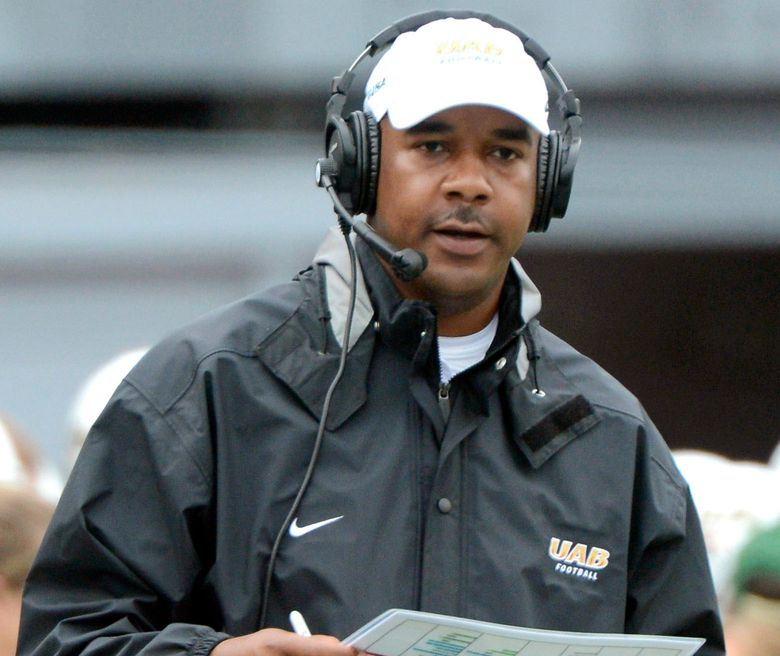 FILE – In this Sept. 21, 2013, file photo, UAB coach Garrick McGee watches the second quarter of an NCAA college football game against Northwestern State at Legion Field in Birmingham, Ala. Florida promoted McGee from analyst to quarterbacks coach Friday, Jan. 29, 2021, filling a vacancy created by Brian Johnson's departure to the NFL's Philadelphia Eagles. McGee spent the 2020 season working behind the scenes at Florida after a two-year stint at Missouri. The former Alabama-Birmingham head coach has bounced from job to job for most of the past decade. (Mark Almond/The Birmingham News via AP, File)