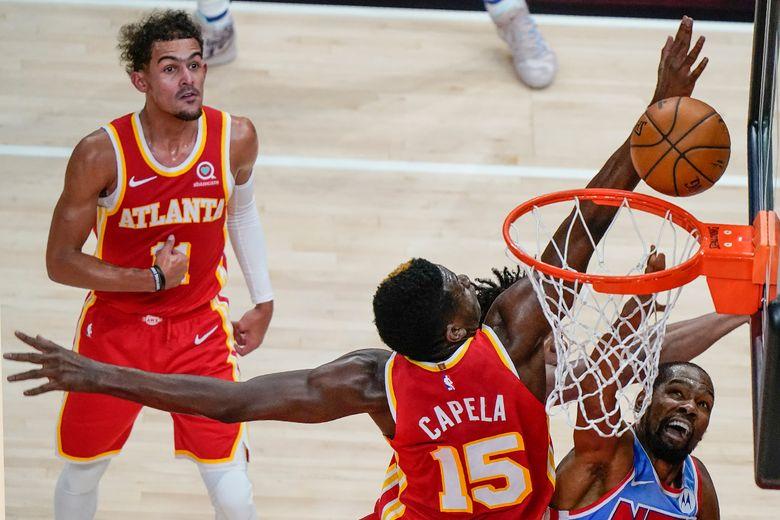 Atlanta Hawks center Clint Capela (15) blocks the ball against Brooklyn Nets forward Kevin Durant (7) during the first half of an NBA basketball game Wednesday, Jan. 27, 2021, in Atlanta. (AP Photo/Brynn Anderson)