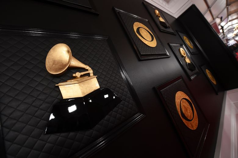 FILE – A view of the red carpet appears prior to the start of the 62nd annual Grammy Awards on Jan. 26, 2020, in Los Angeles. The Recording Academy told The Associated Press on Tuesday, Jan 5. 2021, that the 63rd annual Grammy Awards will no longer take place on its original Jan. 31, 2021, date in Los Angeles and will broadcast in March due to a recent surge in coronavirus cases and deaths.  (Photo by Jordan Strauss/Invision/AP, File)