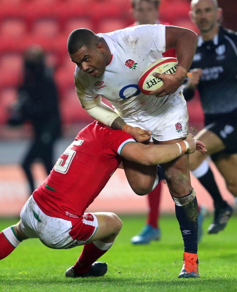 England's Kyle Sinckler is tackled by Wales' Leigh Halfpenny during their Autumn Nations Cup rugby union match at Parc y Scarlets near Llanelli, Wales, Saturday Nov. 28, 2020. (David Davies/PA via AP)