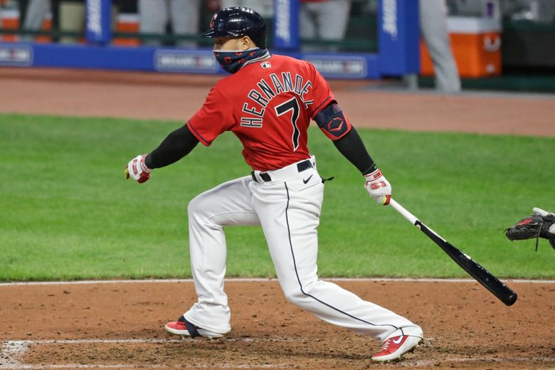 FILE – Cleveland Indians' Cesar Hernandez watches his ball after hitting an RBI-single in the fifth inning in a baseball game against the Cincinnati Reds in Cleveland, in this Wednesday, Aug. 5, 2020, file photo. Free agent second baseman César Hernández has agreed to return to the Cleveland Indians on a 1-year contract, a person familiar with the deal told the Associated Press on Tuesday, Jan. 26, 2021. (AP Photo/Tony Dejak, File)