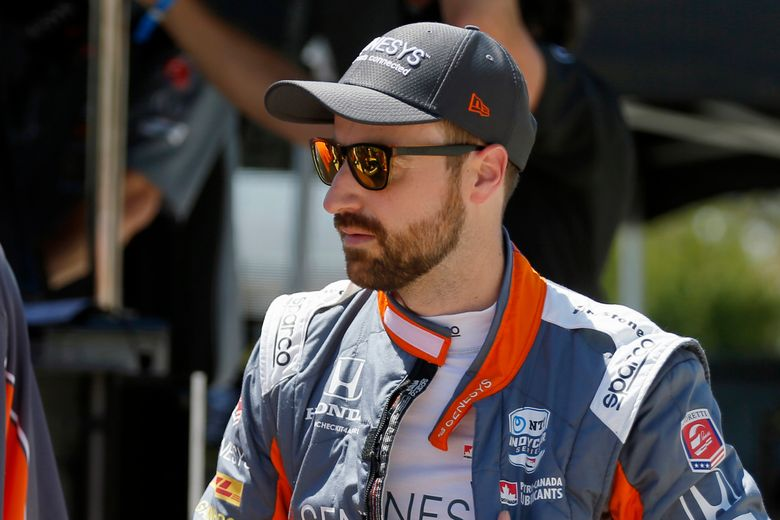 FILE- In this June 6, 2020, file photo, James Hinchcliffe prepares for practice at the IndyCar auto race at Texas Motor Speedway in Fort Worth, Texas. Hinchcliffe will return to Andretti Autosport for a full IndyCar season, a huge recovery after the popular Canadian cobbled only six races together last year. (AP Photo/Tony Gutierrez, File)