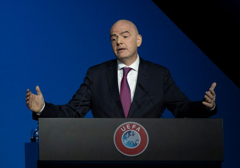 FILE – In this Tuesday March 3, 2020 file photo, FIFA President Gianni Infantino addresses a meeting of European soccer leaders at the congress of the UEFA governing body in Amsterdam, Netherlands. Human rights activists are denouncing FIFA President Gianni Infantino's starring turn in a promotional video for the Saudi Arabian government in which he claims the kingdom has made important changes. The slick 3½-minute PR campaign was posted on Twitter by the Saudi ministry of sport on Thursday Jan. 7, 2021, featuring Infantino participating in a ceremonial sword dance and sweeping shots of the palaces of Diriyah. (AP Photo/Peter Dejong, File)