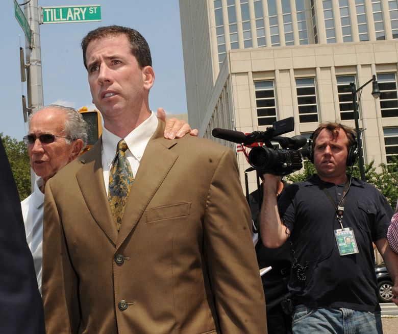 FILE – In this July 29, 2008, file photo, former NBA referee Tim Donaghy exits Brooklyn federal court following his sentencing after pleading guilty to federal charges that he took payoffs from a professional gambler for inside tips on games. The disgraced former NBA referee is back, and again this time he's fixing the result, only with his employer's permission. Donaghy made his debut for Major League Wrestling this week in nefarious fashion. (AP Photo/Louis Lanzano, File)