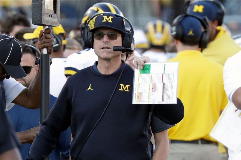 FILE – In this Jan. 1, 2020, file photo, Michigan head coach Jim Harbaugh paces the sideline during the second half of the Citrus Bowl NCAA college football game against Alabama in Orlando, Fla. Michigan has decided to stick with Harbaugh. He has finalized a new, five-year deal with a base salary of $4 million per year. He can make as much as $8 million with incentives, according to a person familiar with the contract who spoke to The Associated Press. (AP Photo/John Raoux, File)