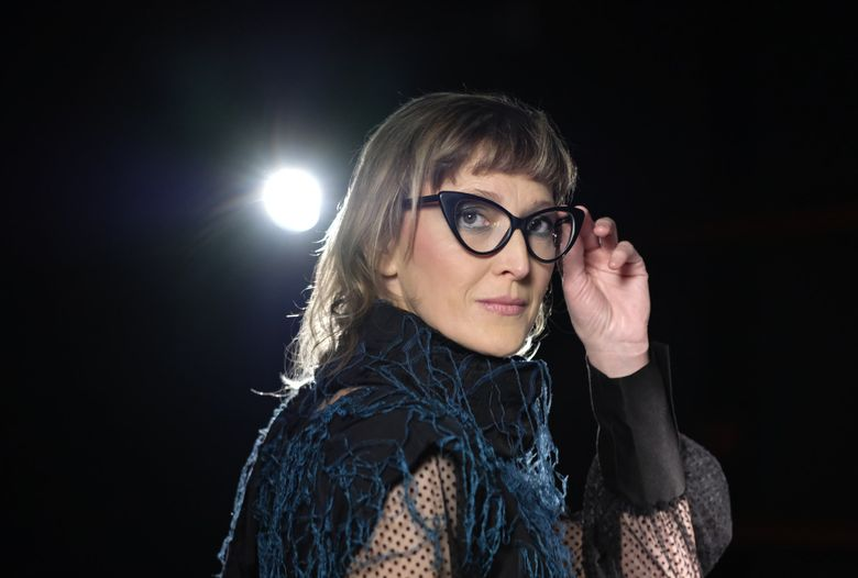 """Bosnian filmmaker Jasmila Zbanic poses during an interview in Sarajevo, Bosnia, Jan. 30, 2021. Zbanic's latest and the most ambitious film """"Quo Vadis, Aida?"""", based on true events from Bosnia's brutal 1992-95 inter-ethnic war has been many years in the making. (Kemal Softic / The Associated Press)"""