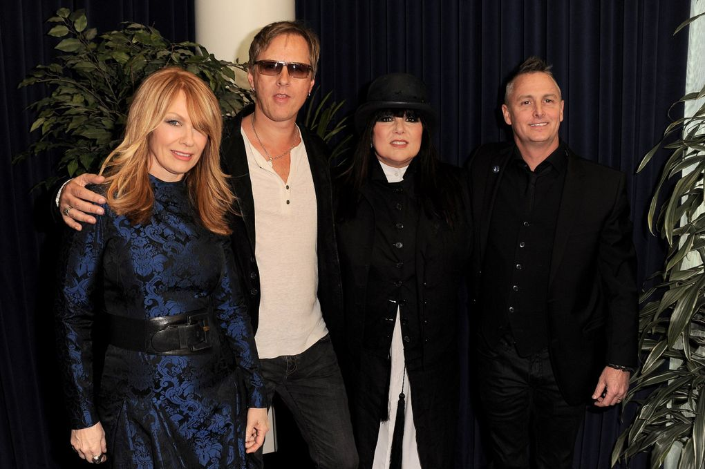 """From left: Nancy Wilson of Heart, Jerry Cantrell of Alice in Chains, Ann Wilson of Heart and Mike McCready of Pearl Jam attend the Rock & Roll Hall of Fame induction ceremony in Los Angeles in 2013, when Heart was inducted. """"They've always been there for us, man,"""" Cantrell says of Ann and Nancy Wilson. """"All of us. All of the next generation of bands that came up."""" (Jordan Strauss / Invision / The Associated Press)"""
