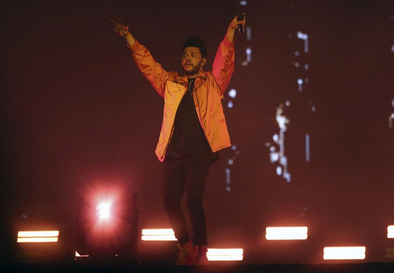 Pop star The Weeknd has plans for two Western Washington shows next year, including a March 4, 2022 date at Climate Pledge Arena. In this photo, he's performing during a 2018 Yasalam After-Race concert at the Yas Island in Abu Dhabi, United Arab Emirates. (Mahmoud Khaled / AP)