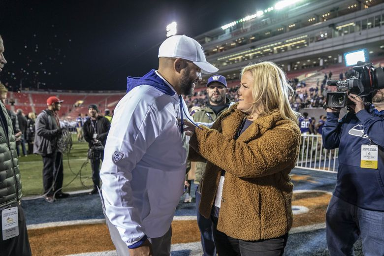 Jimmy Lake meets with Washington Athletic Director Jennifer Cohen after the Huskies defeated Boise State in the Las Vegas Bowl in 2019. (Dean Rutz / The Seattle Times)