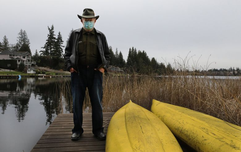 """Greg Bear, winner of multiple Nebula and Hugo awards for his science fiction, on Feb. 11 at the edge of Martha Lake. His latest release, """"The Unfinished Land,"""" is something like the 37th book in Bear's bibliography; he stopped counting years ago. (Alan Berner / The Seattle Times)"""