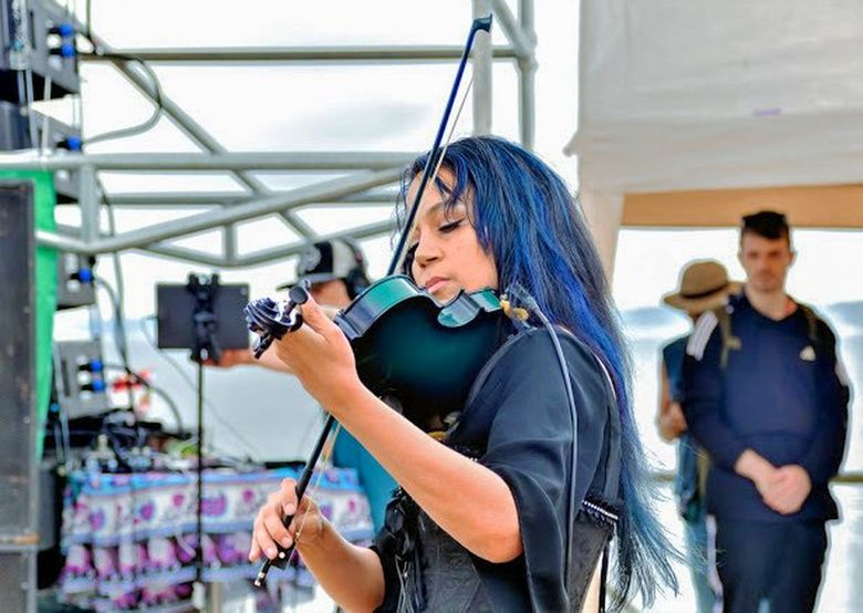 """Jimi Hendrix's niece Tina Hendrix performed """"The Star-Spangled Banner"""" at the 2019 Seattle Hempfest to mark the 50th anniversary of her uncle's iconic Woodstock performance.  (J Joshua Diltz)"""