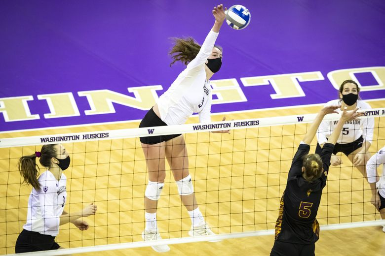 Washington opposite hitter Samantha Drechsel gets a kill in the third set against Arizona State in January. (Bettina Hansen / The Seattle Times)