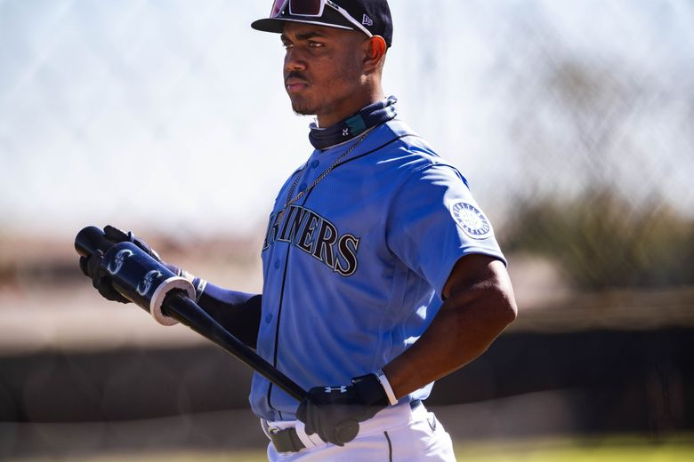 Julio Rodriguez waits his turn in the batting cage Wednesday.  The Seattle Mariners held Spring Training February 23, 2021 In Peoria, AZ. 216469 (Dean Rutz / The Seattle Times)
