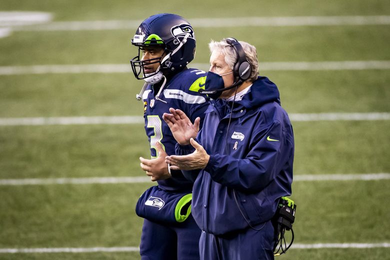 Seahawks quarterback Russell Wilson and head coach Pete Carroll celebrate kicker Jason Myers' field goal to make the final score 40-3 as the Seahawks took on the New York Jets at Lumen Field on December 13, 2020. (Bettina Hansen / The Seattle Times)